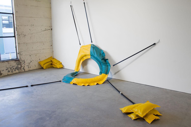 Mie Hørlyck Mogensen,   Coast Guard (ring),   2016      Vinyl, sand, rubber.