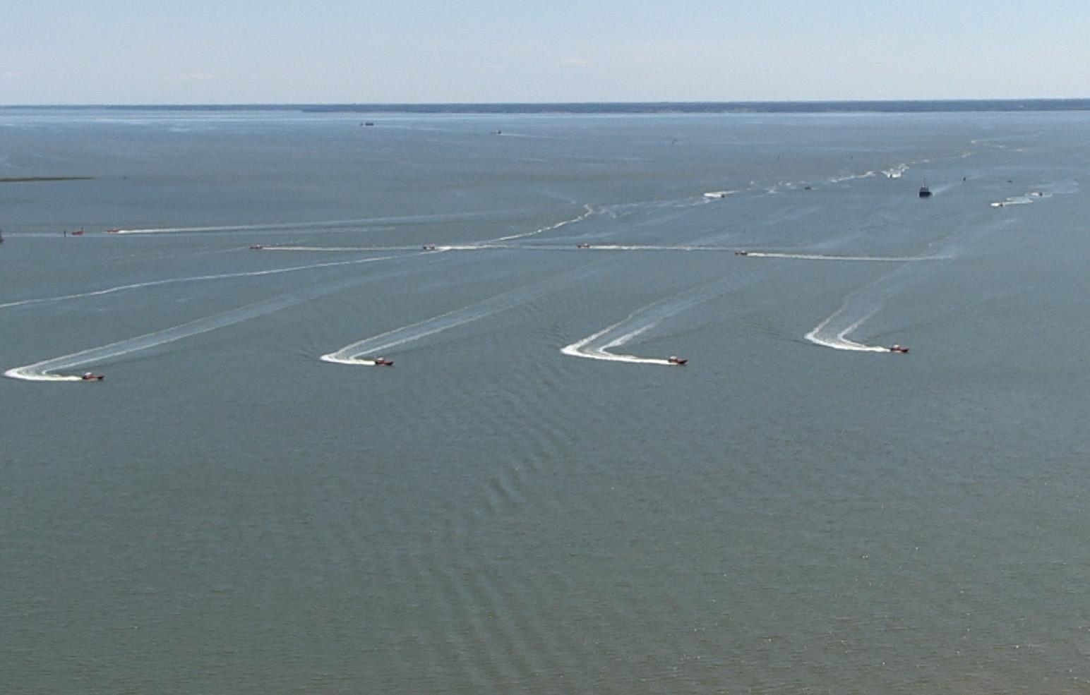 Unmanned Naval watercraft operating under swarm intelligence programming.  Image Credit: DefenseTech.org