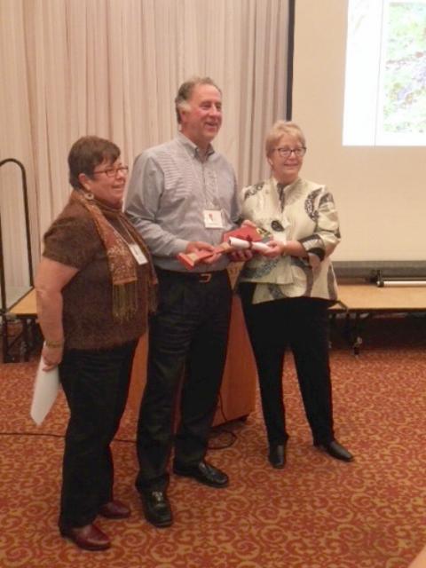 Haliburton Highlands Land Trust Chair Mary Lou Gerstl, PLCA President Mike Thomas, and board member Pat Warren at the 2016 HHLT gala.