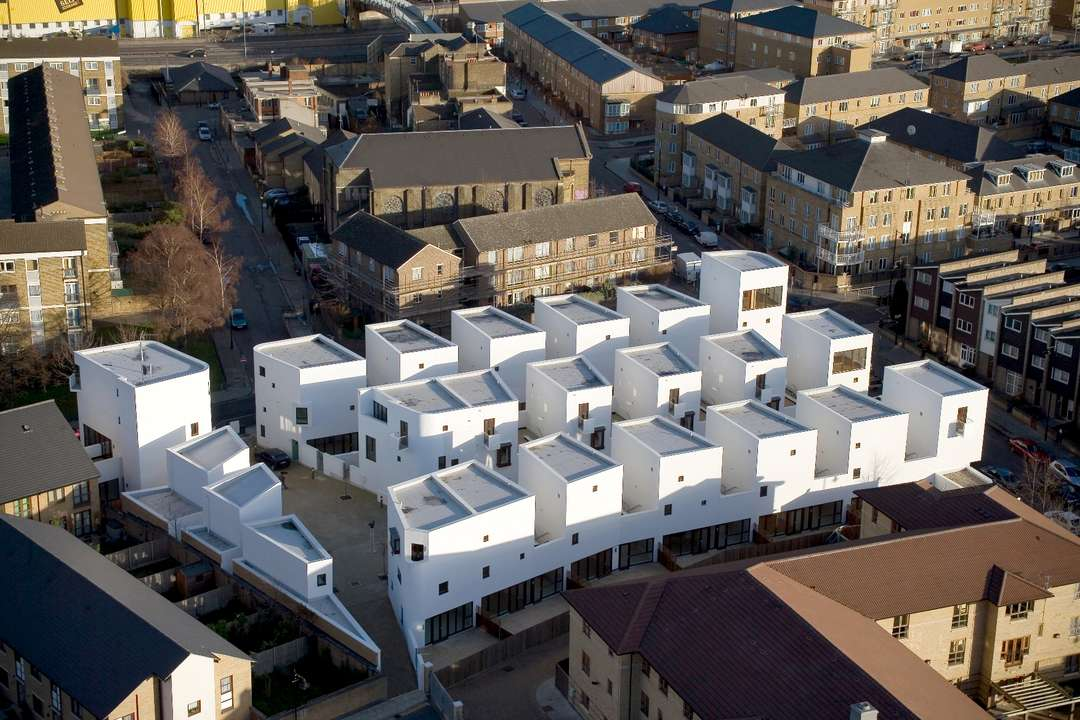 """As cities around the world struggle with solutions to the housing shortage that faces many communities, one urban building typology has been floated for decades that might increase housing units without reducing quality of life: low-rise, high-density. Emerging in the 1960s and 70s as an antidote to the severe """"tower in the park"""" model offered by Le Corbusier and others, this housing typology had the potential to overcome some of the downsides of massive urban renewal in its emphasis on livable scale and community context."""