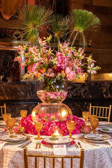 "Architectural Digest. April, 2018  Natalie Kraiem  ""Inspired by the gorgeous flowers in Giverny, France, I created a tablescape with a floating garden and exotic flowers,"" explains Kraiem. A tablecloth in fabric from Kravet made a graphic foil to the romance of pink flowers and gold glassware."