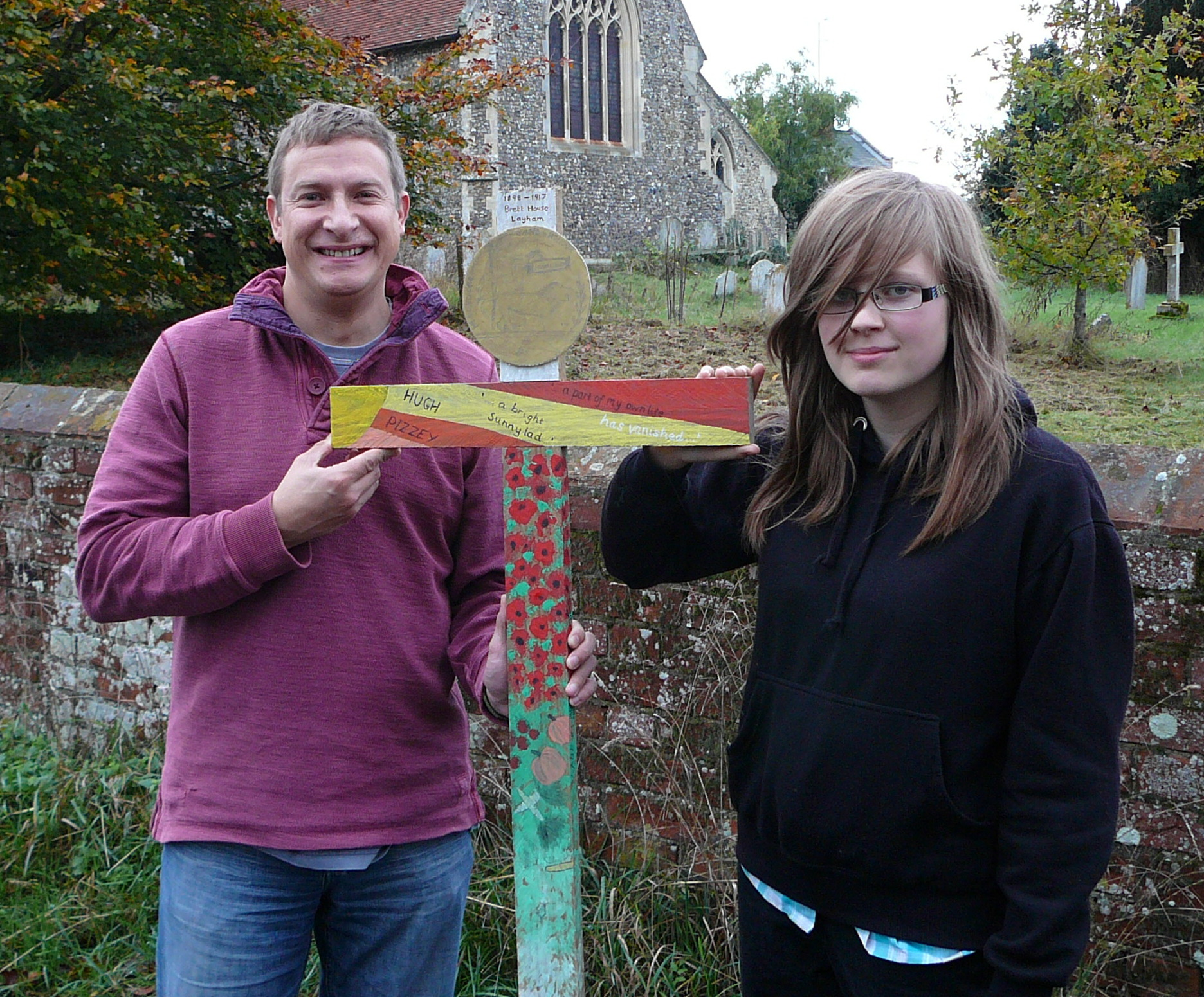 121 ANDREW FROLISH AND MOLLY KEEBLE WITH THE CROSS IN MEMORY OF HUGH PIZZEY.jpg