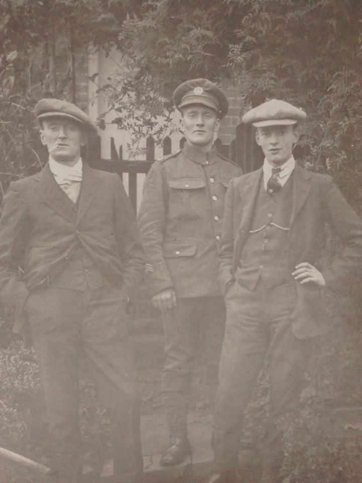 Charles Mitchell with his brothers outside their house on Angel Street