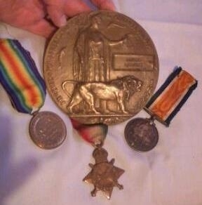 Alfred Lambert's medals and memorial plaque.