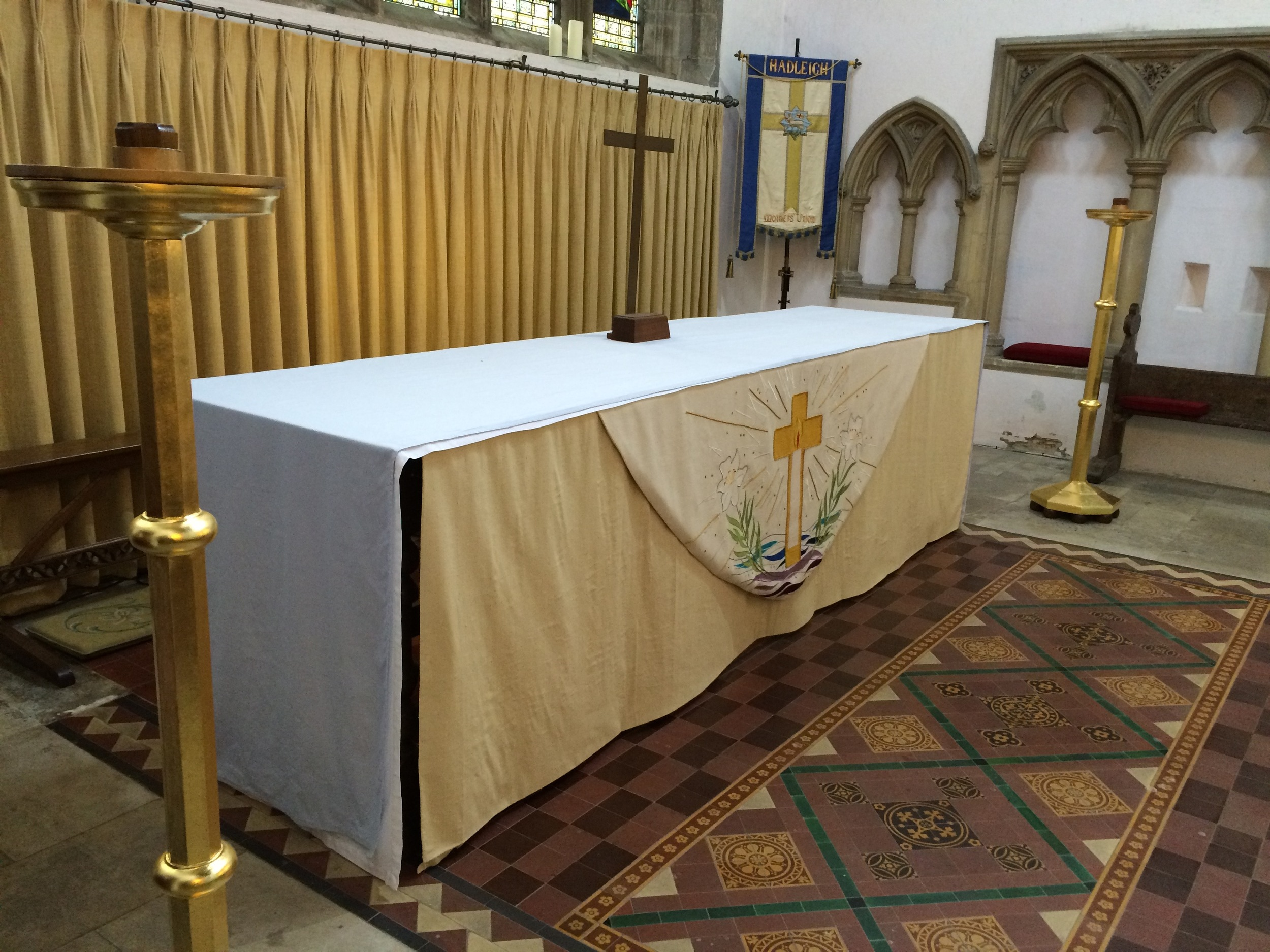 The recently refurbished candle sticks by the `high altar at St Mary's, Hadleigh.