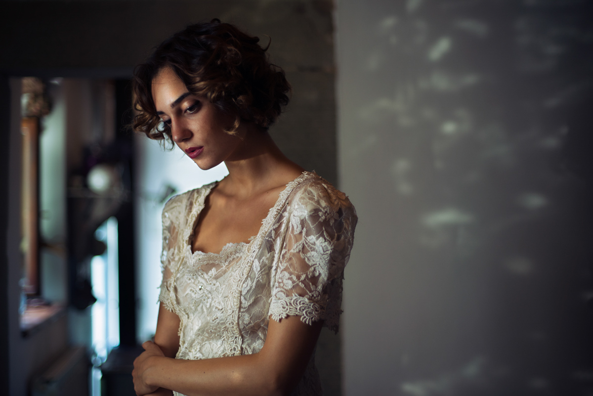 Portrait of a model in a white lacy dress