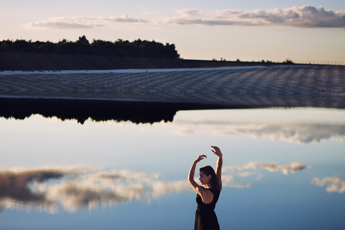 Girl with clouds in a lake