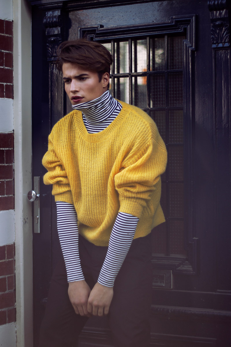 Male model in a yellow sweater