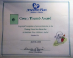 "Sample Thank You Certificate - Green Thumb Award (with ink thumb print in green box) for volunteers for ""Putting Down New Roots Day""  - This award was given to volunteers who put in hundreds of hours landscaping around a newly constructed children's shelter."