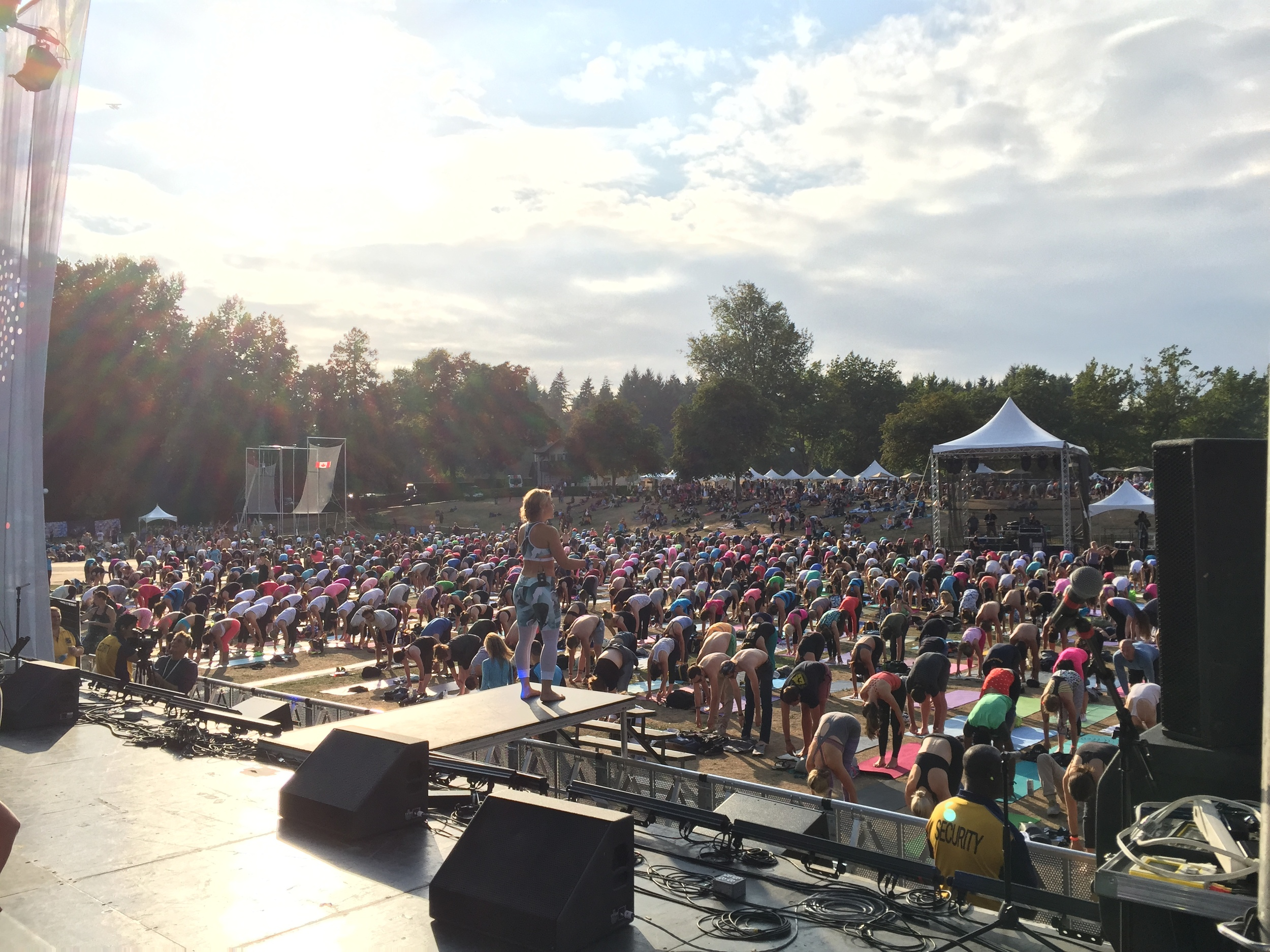 Thousands participate in Sunset Yoga with the fabulous Alex Mazerolle.
