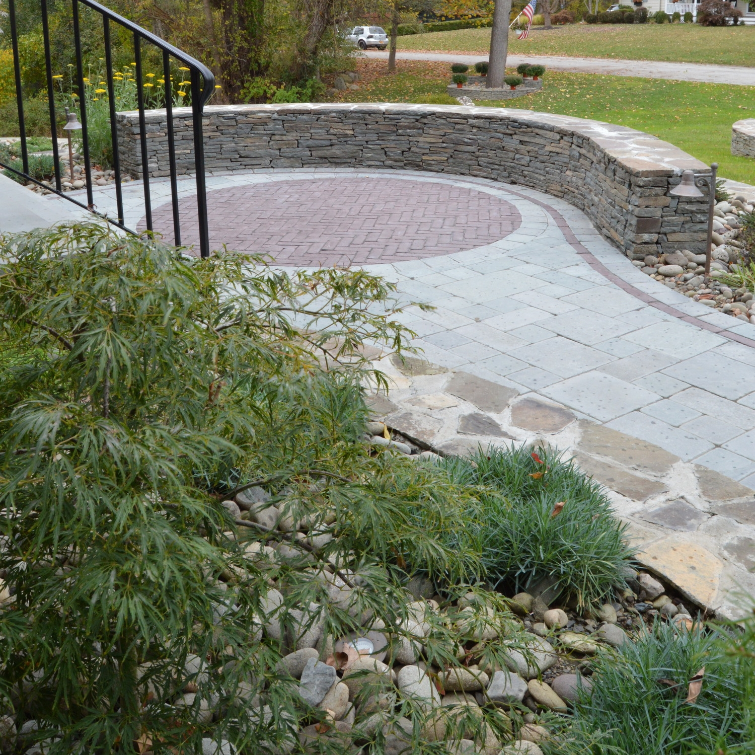 This Landworx project is located in Orange County, NY region of the Hudson Valley.  The design includes the masterful use of natural stone walls and real bluestone pavers, with colorful accents made from Copthorne—a concrete paver from Unilock's Select line.