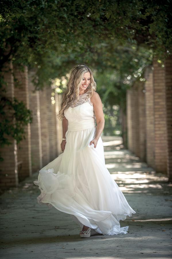 01_After_wedding_smiling_bride_flower_corridor_location_athens.jpg