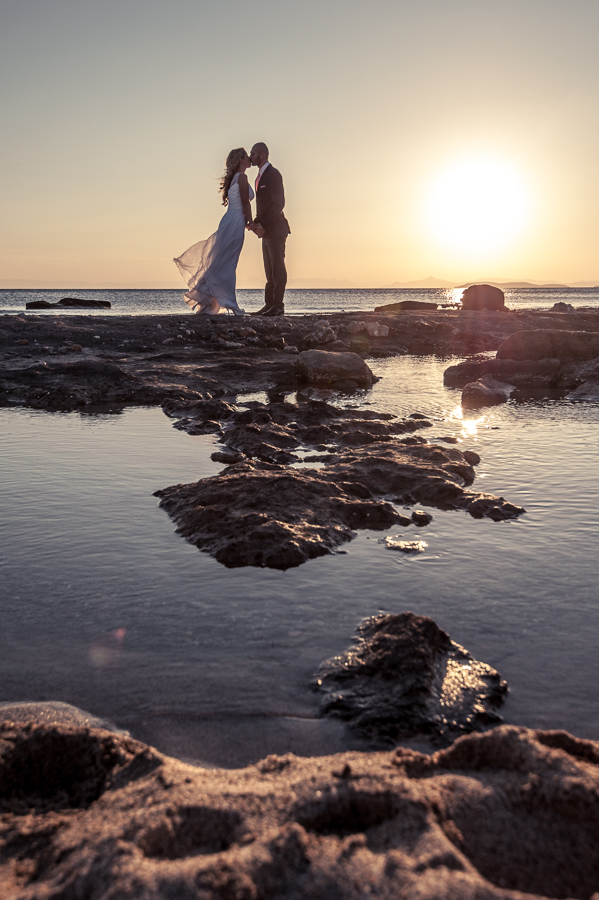 09_After_wedding_location_athens_bridal_kiss_groom_bride_breeze_sea_sun_reflections.jpg
