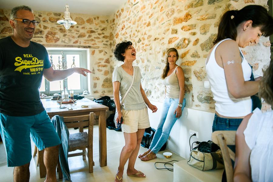 20_Wedding in Folegandros guests laughing.jpg