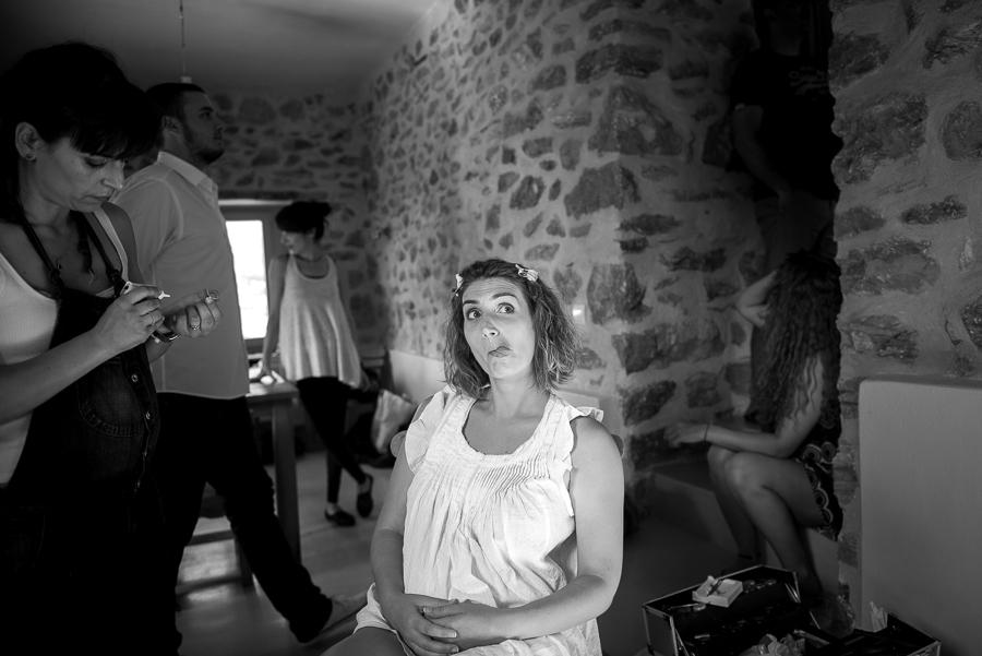 23_Wedding in Folegandros bride doing face.jpg