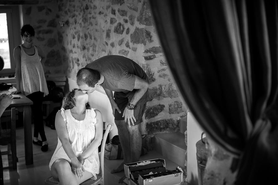 24_Wedding in Folegandros bride kisses groom.jpg