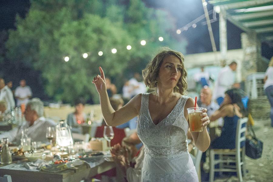 167_Wedding in Folegandros beach party bride.jpg