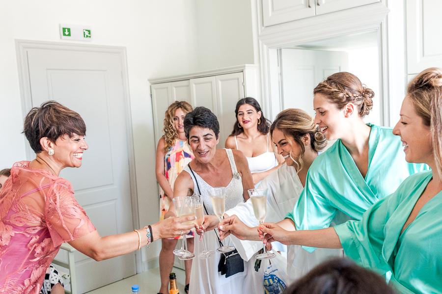 80_Hydra_wedding_photographer champaigne cheers.jpg