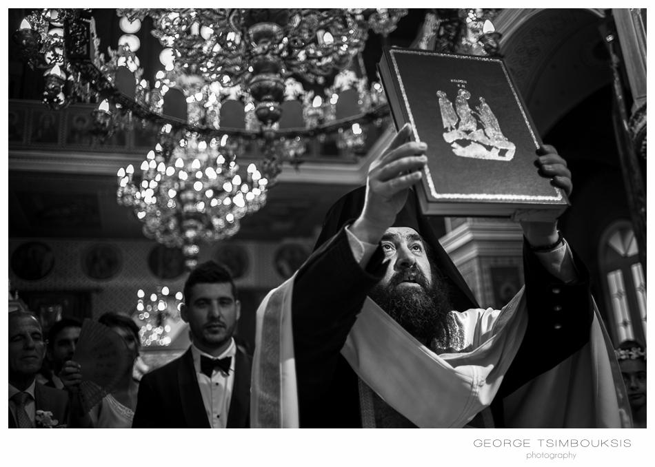 113_Wedding in Chios priest in light.jpg