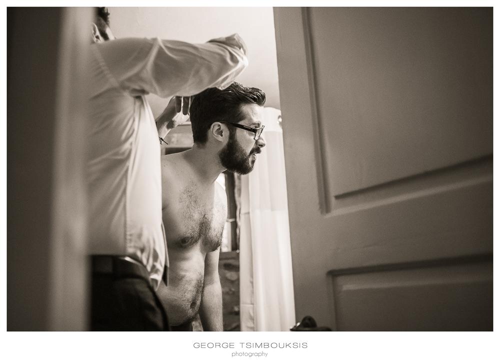 57_Wedding in Mystras_groom looking the mirror.jpg