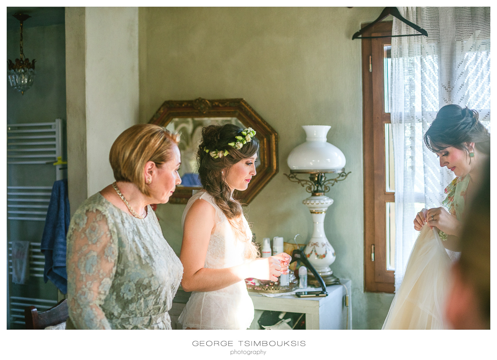 88_Wedding in Mystras_putting the wedding dress.jpg