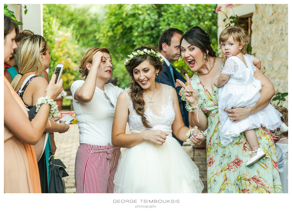 105_Wedding in Mystras_sister and bride rocking it.jpg