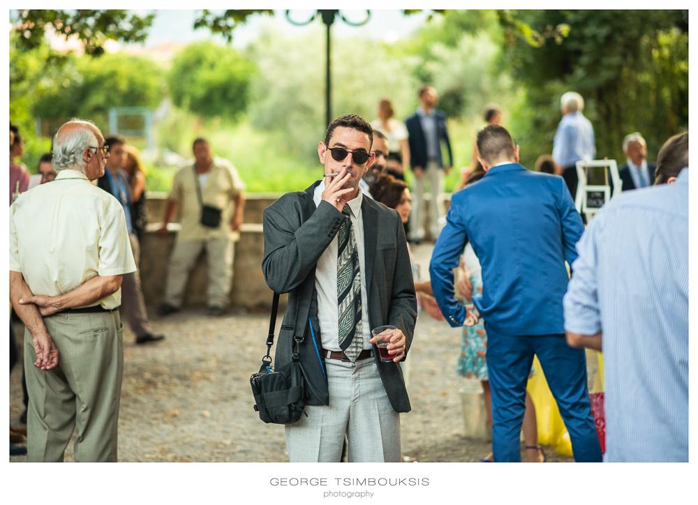 117_Wedding in Mystras_smoke a cigar.jpg