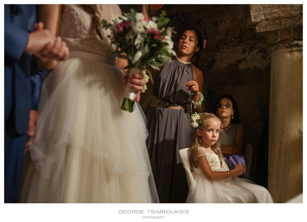 132_Wedding in Mystras_church kid portrait.jpg