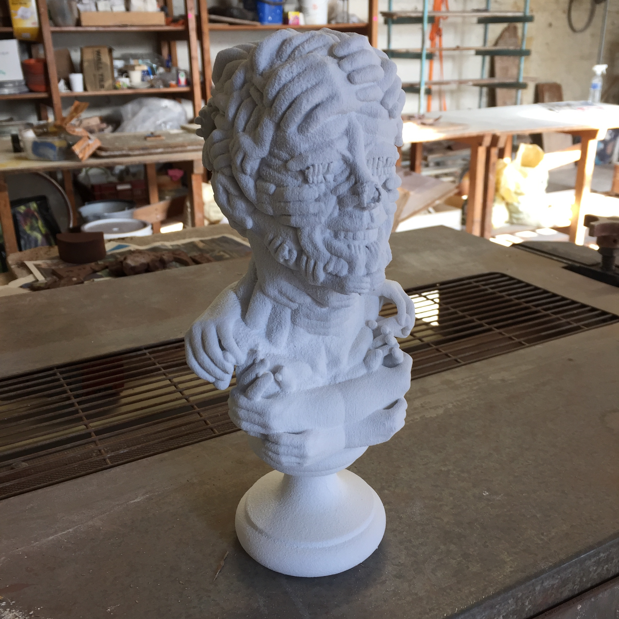 A bust by John Rainey, awaiting biscuit firing.