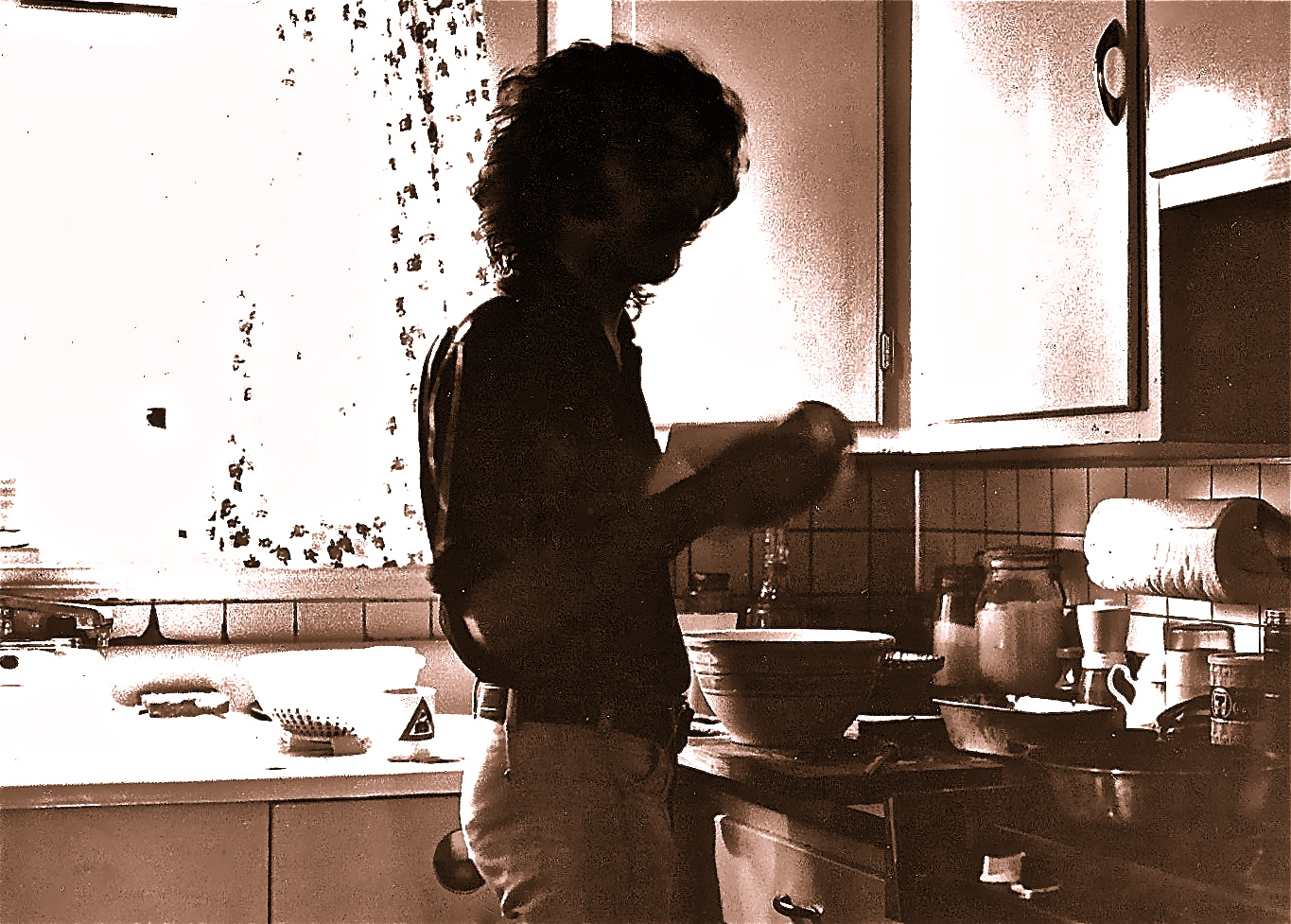 "Photograph, captioned ""My cousin in my kitchen,"" by Marcel Piron, 1975. Salt print on Arches aquarelle paper. (Portrait of Denis LaCloche.)"