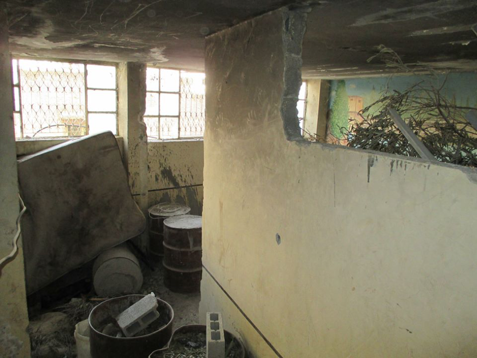 The inside of a home that was demolished and filled with cement barrels so that it could not be rebuil