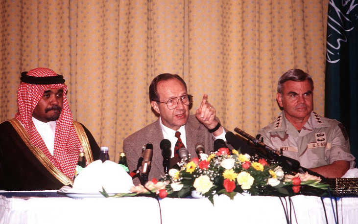 Saudi Prince Bandar bin Sultan al Saud (left) at a press conference with U.S. Secretary of Defense William J. Perry and General J.H. Binford Peay III after a terrorist attack in Khobar, Saudi Arabia in 1996. Washington and Prince Bandar were instrumental in diffusing a 1999 conflict between India and Pakistan, as well as a Pakistani coup d'etat.