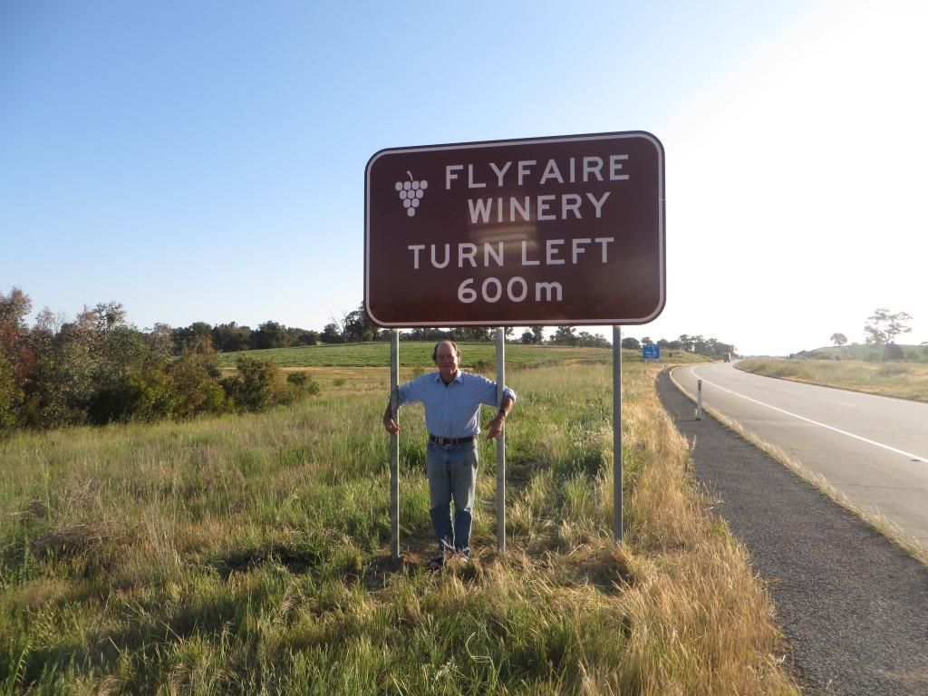 Les, our Winemaker, with Flyfaire's new Sign on Hume Highway M31