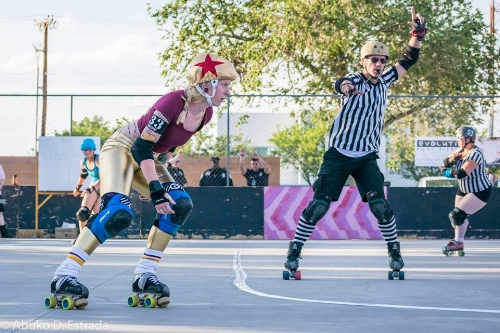 Fowl Play declares DCRD's BeeBop lead jammer at a 2016 home team bout. Photo by Abuko D. Estrada