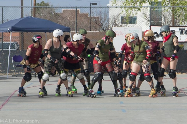 Hazard (in green, second Dame from the right) suited up with the Dooms Dames for her first bout in March. Photo by M.A.L. Photography.