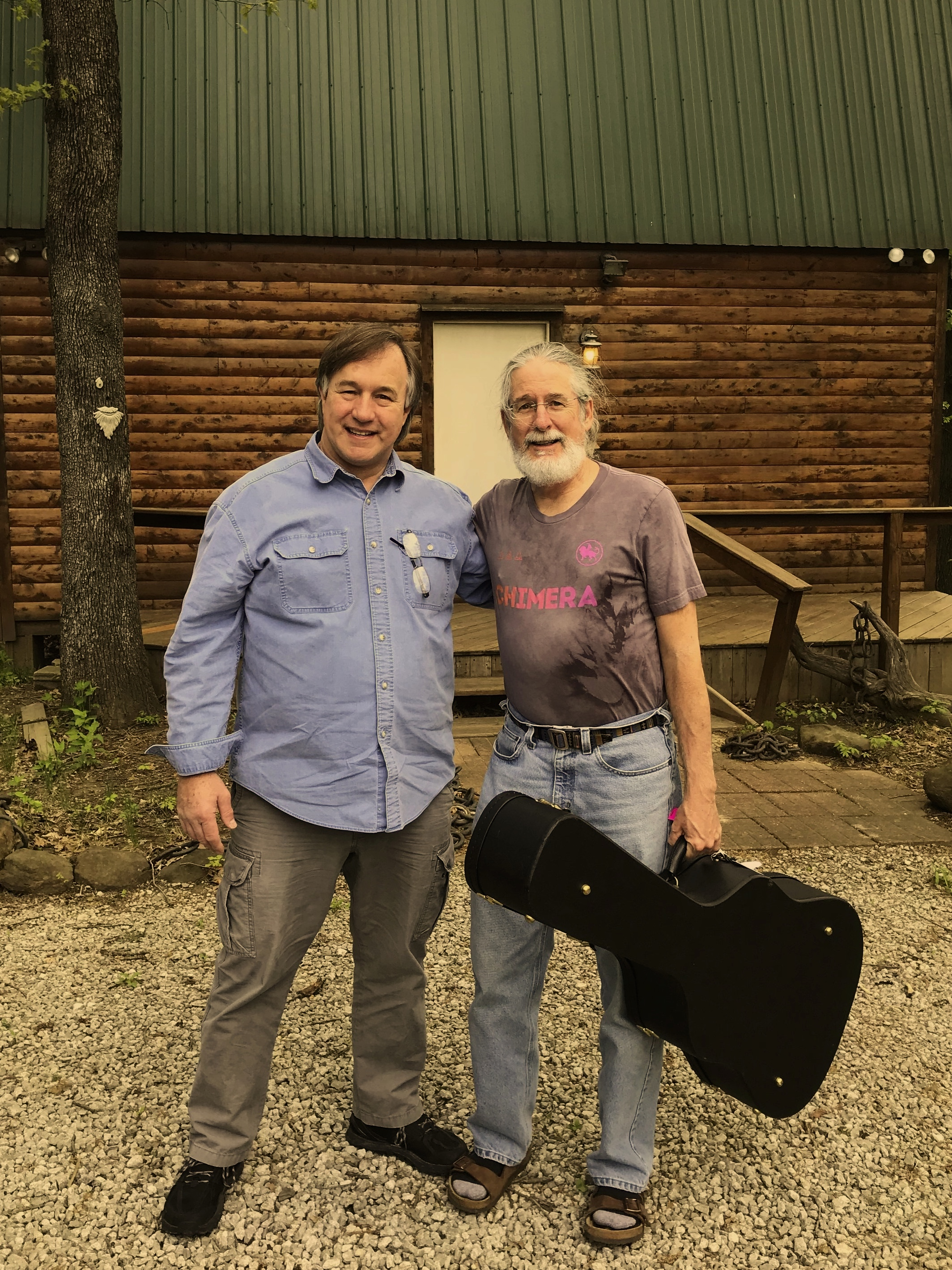 "WALT AND JOHN IN FRONT OF WALT'S RECORDING STUDIO ""BARN"" IN BROKEN ARROW, OKLAHOMA"