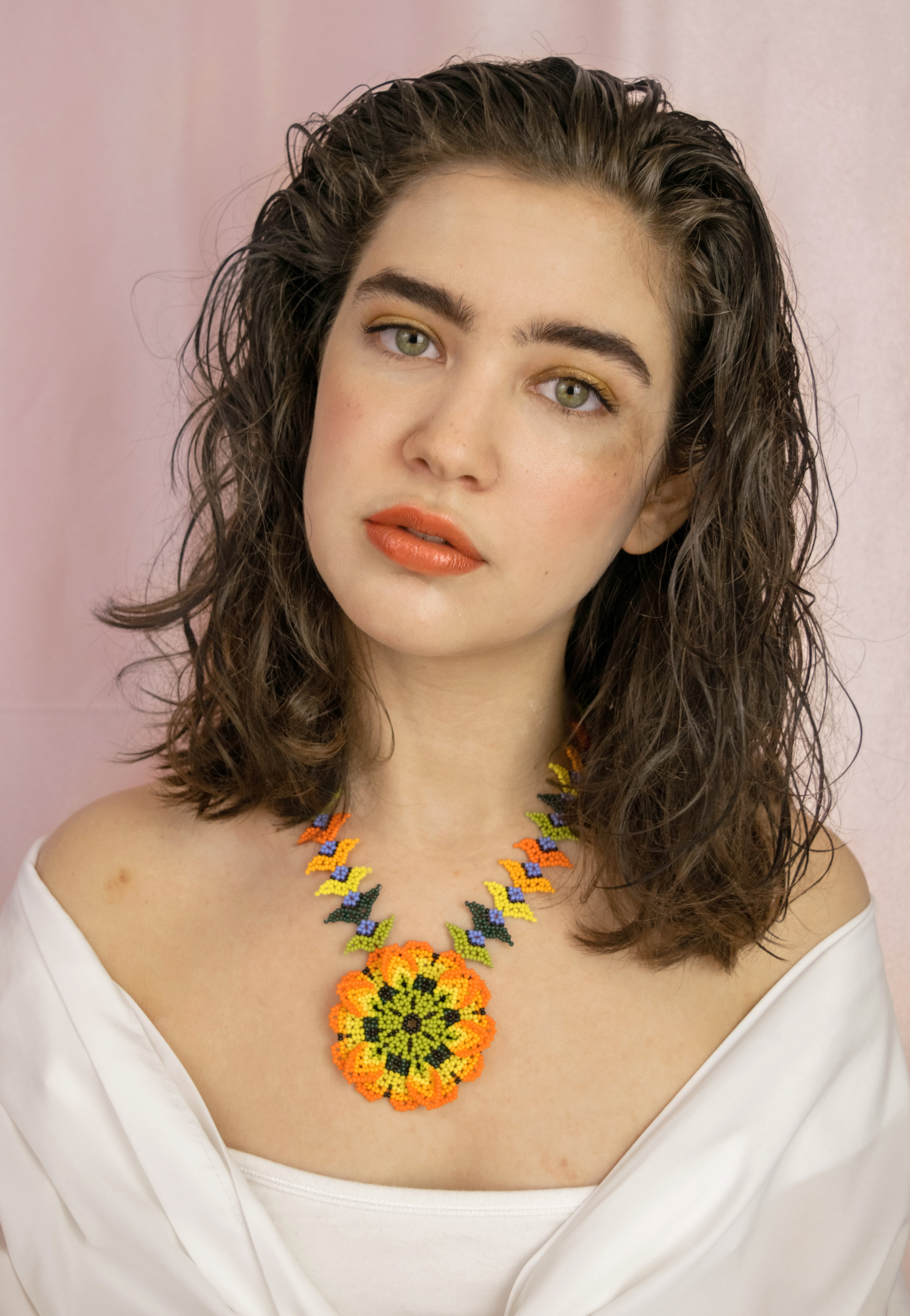 Karla is wearing Au Naturale's High Lustre Lip Gloss in Poppy.