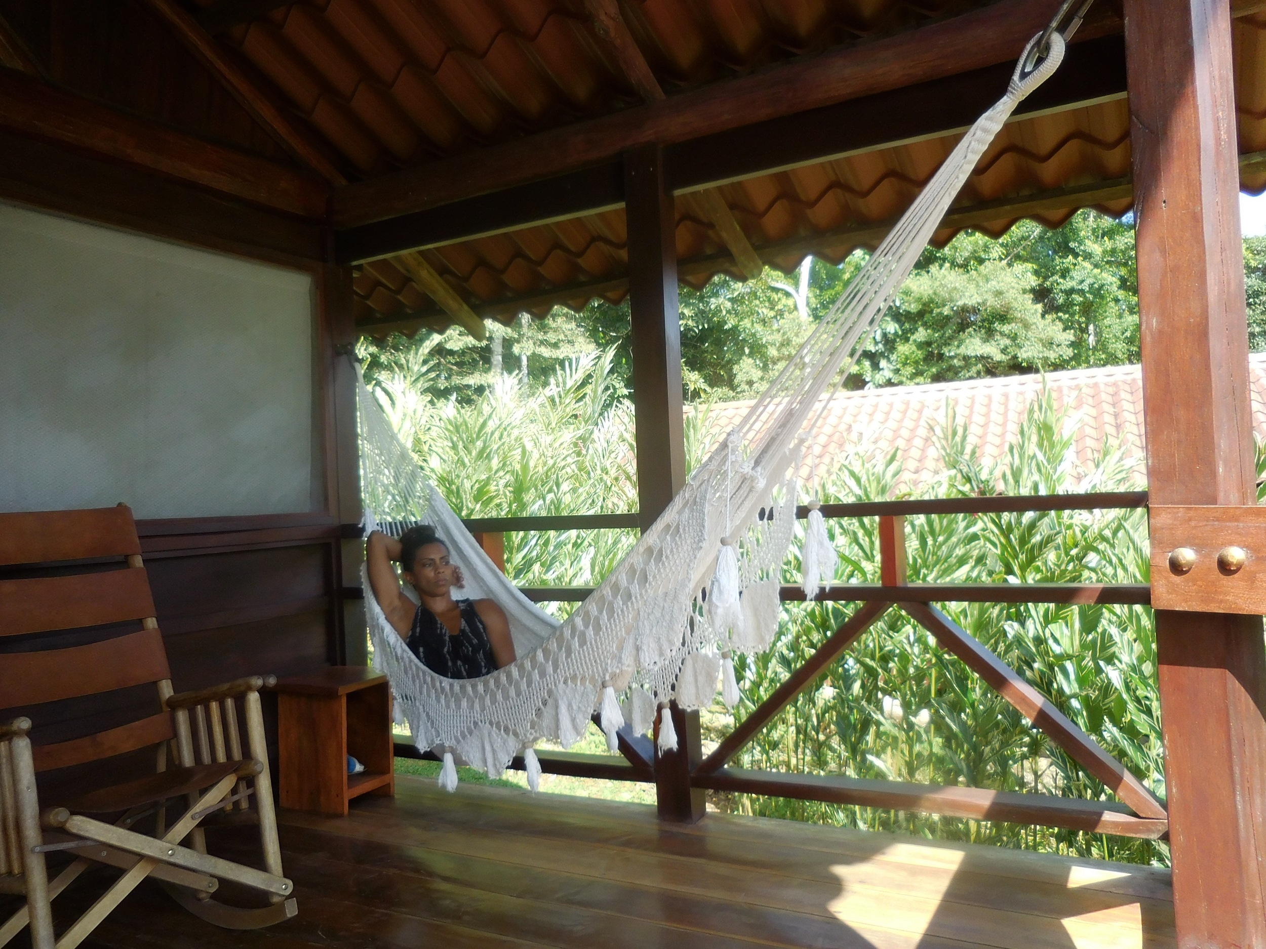 Laying in the hammock on my porch in the rainforest.