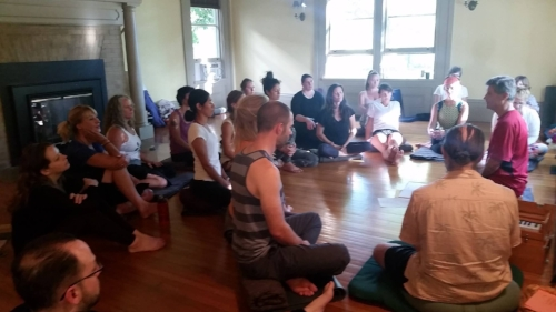 Bill Mahony leading a yoga philosophy lecture and discussion.