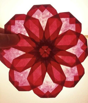 A Hibiscus flower design made of transparent paper  ·  Courtesy of Nakamuraya