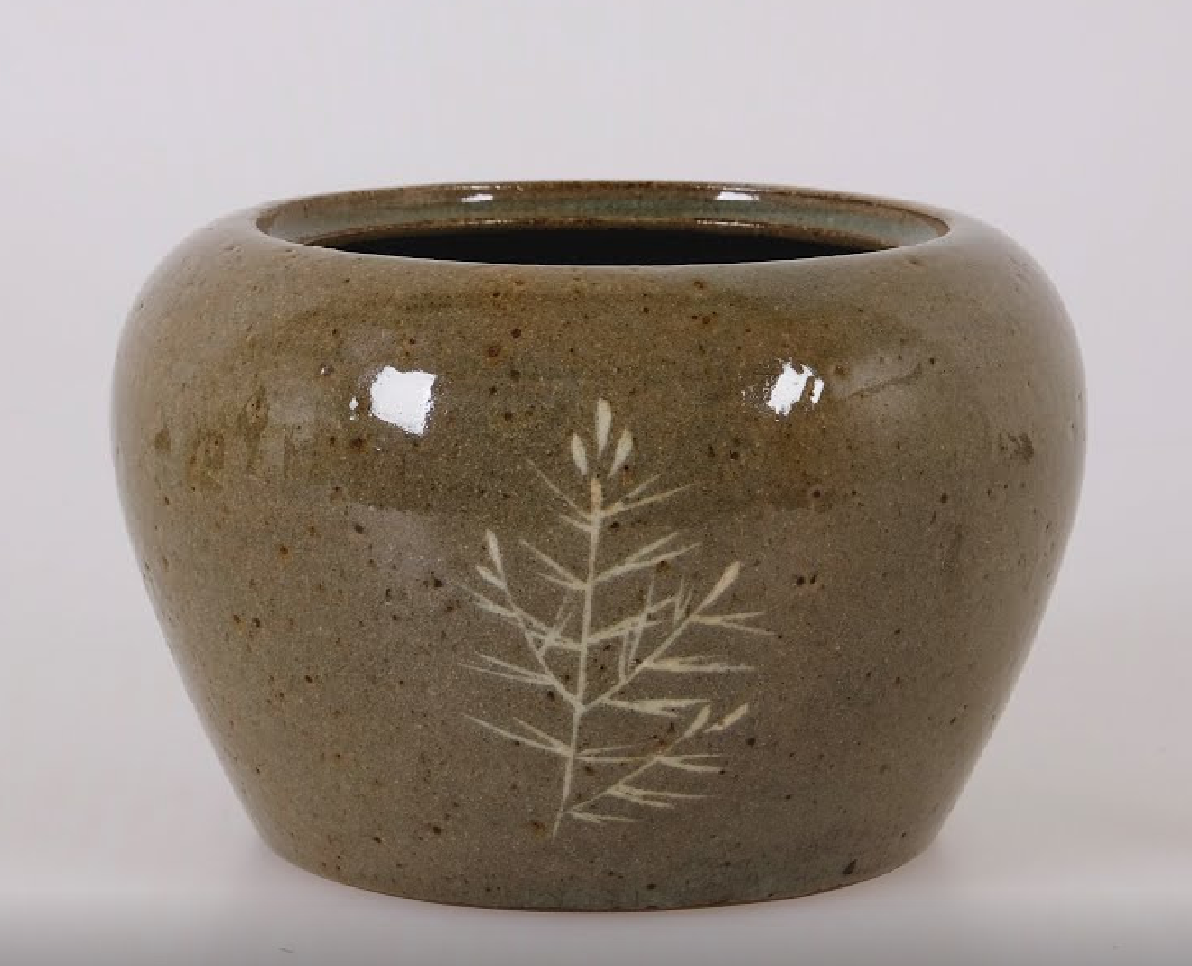 This mizusashi (water container for tea ceremony) with inlay of organized lines representing a young pine tree is exemplary of the type of fine inlay applied to Yatsushiro wares during the 19th century. Agano Noguma (1795-1871) Kyoto Women's University, Lifestyle Design Laboratory (Google Arts + Culture)