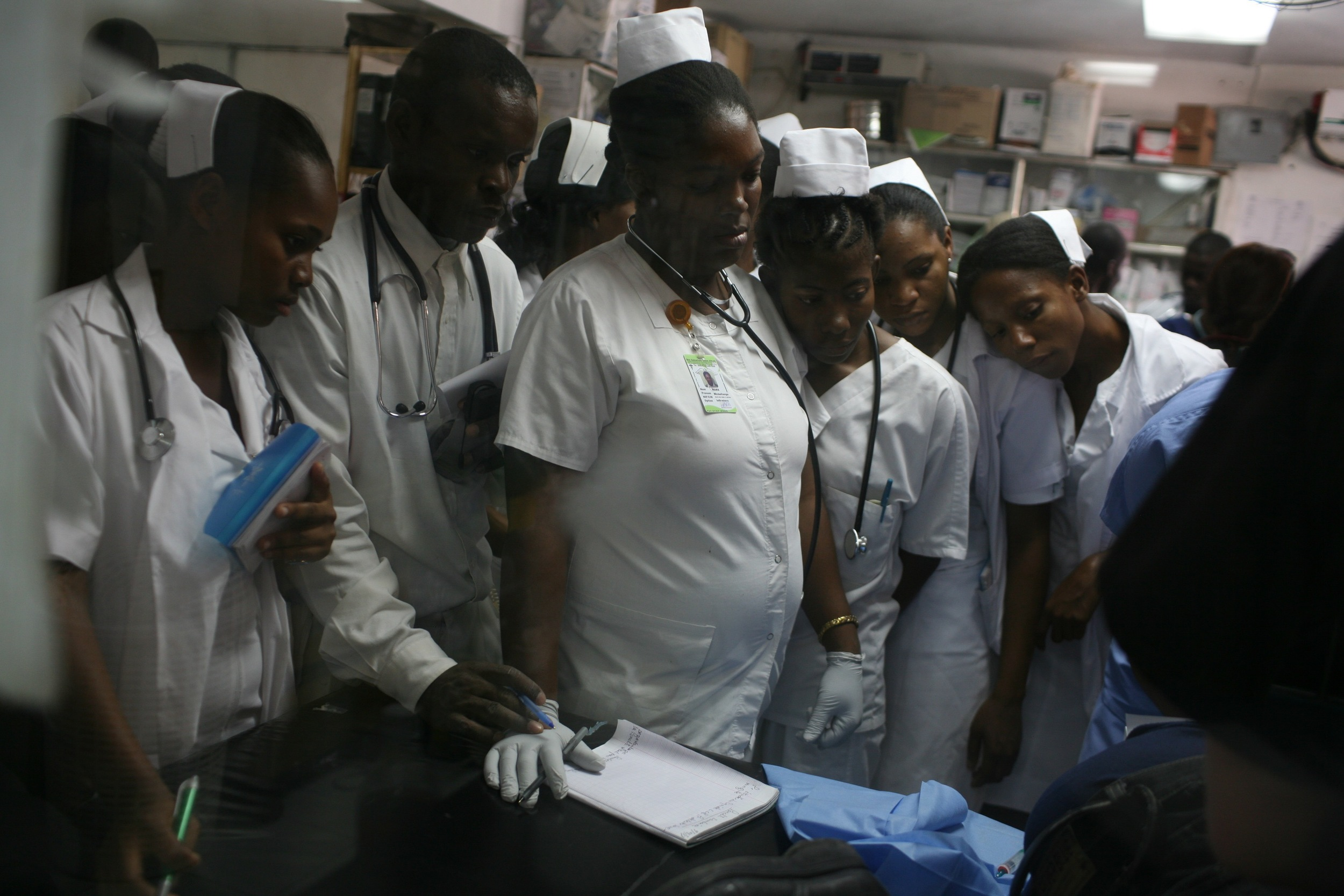 Haitian students eagerly wanting to learn from the new technology
