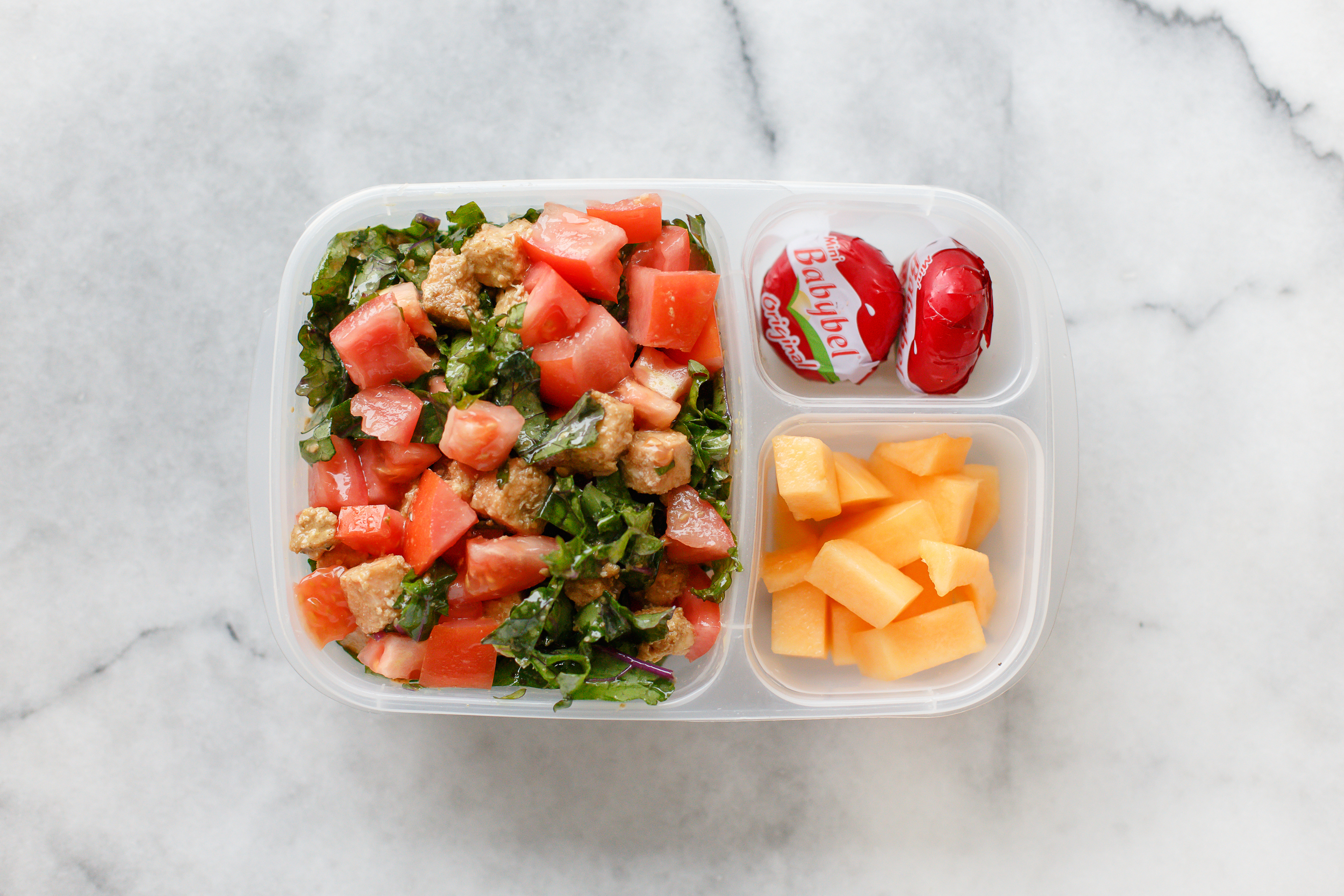 Mondays are my busiest day, and I'm so much happier when I remember to make a lunch for me too. This was a super quick salad of kale, tomatoes, and leftover salmon burger, just tossed in a very quick dressing of sesame oil and Bragg's Aminos, with some melon and cheese on the side.