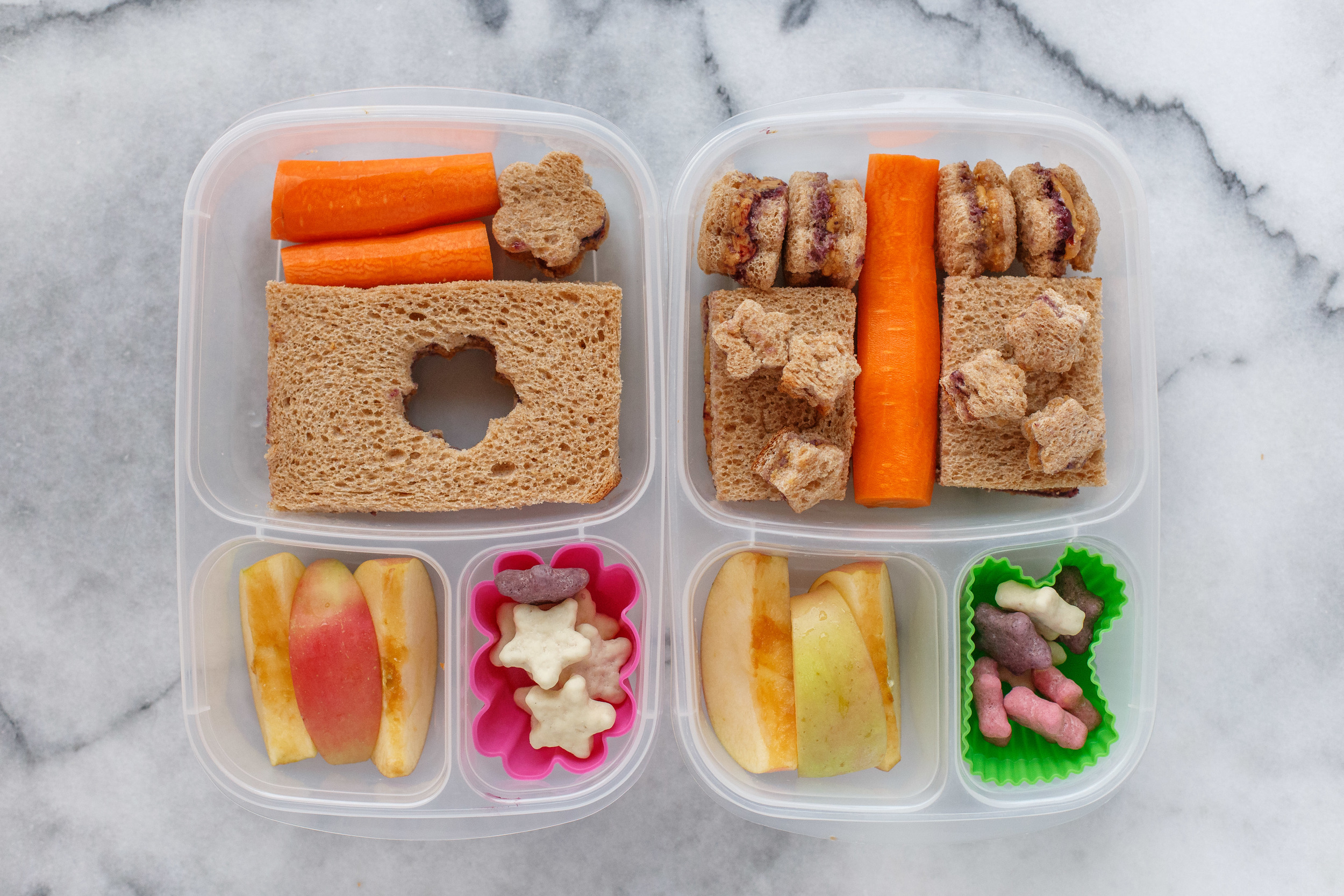 Wednesday: two stayed home sick, so only two lunches.  Peanut butter & jam on whole wheat bread, with carrots, apple, and yogurt covered star cookies.