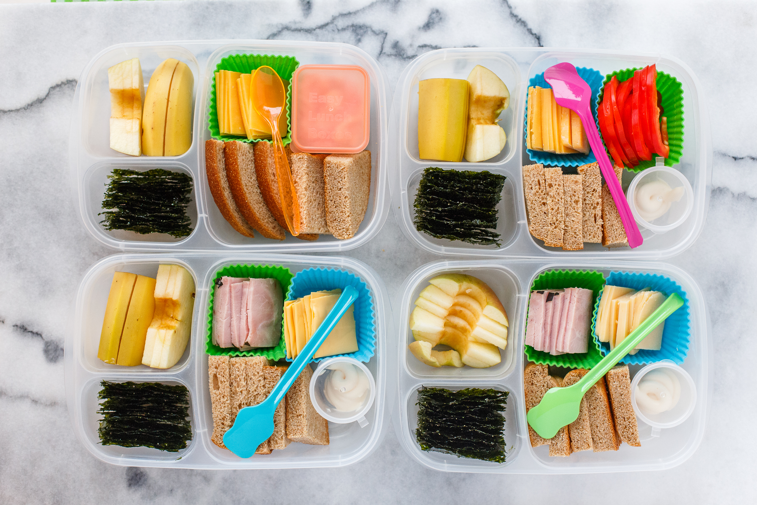 Thursday: make your own sandwich kits! Honey wheat bread, slices of cheese, mayo, two have ham, one has sweet red peppers, and one who doesn't like mayo has a side of yogurt instead. Plus seaweed snacks, apple, and banana.