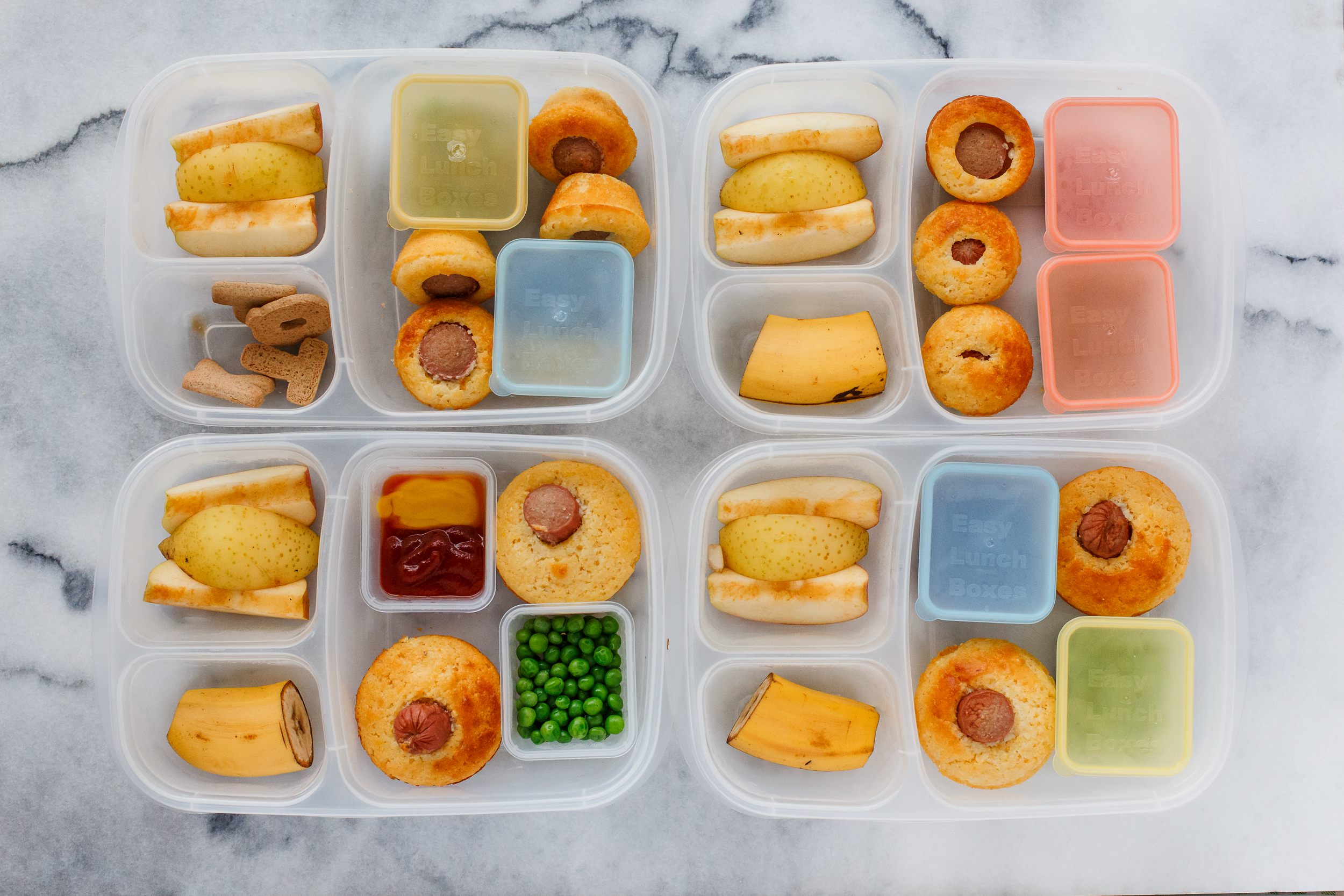 Friday! Corn dog muffins ( recipe here ), with ketchup and mustard, peas, banana, apple & pears.