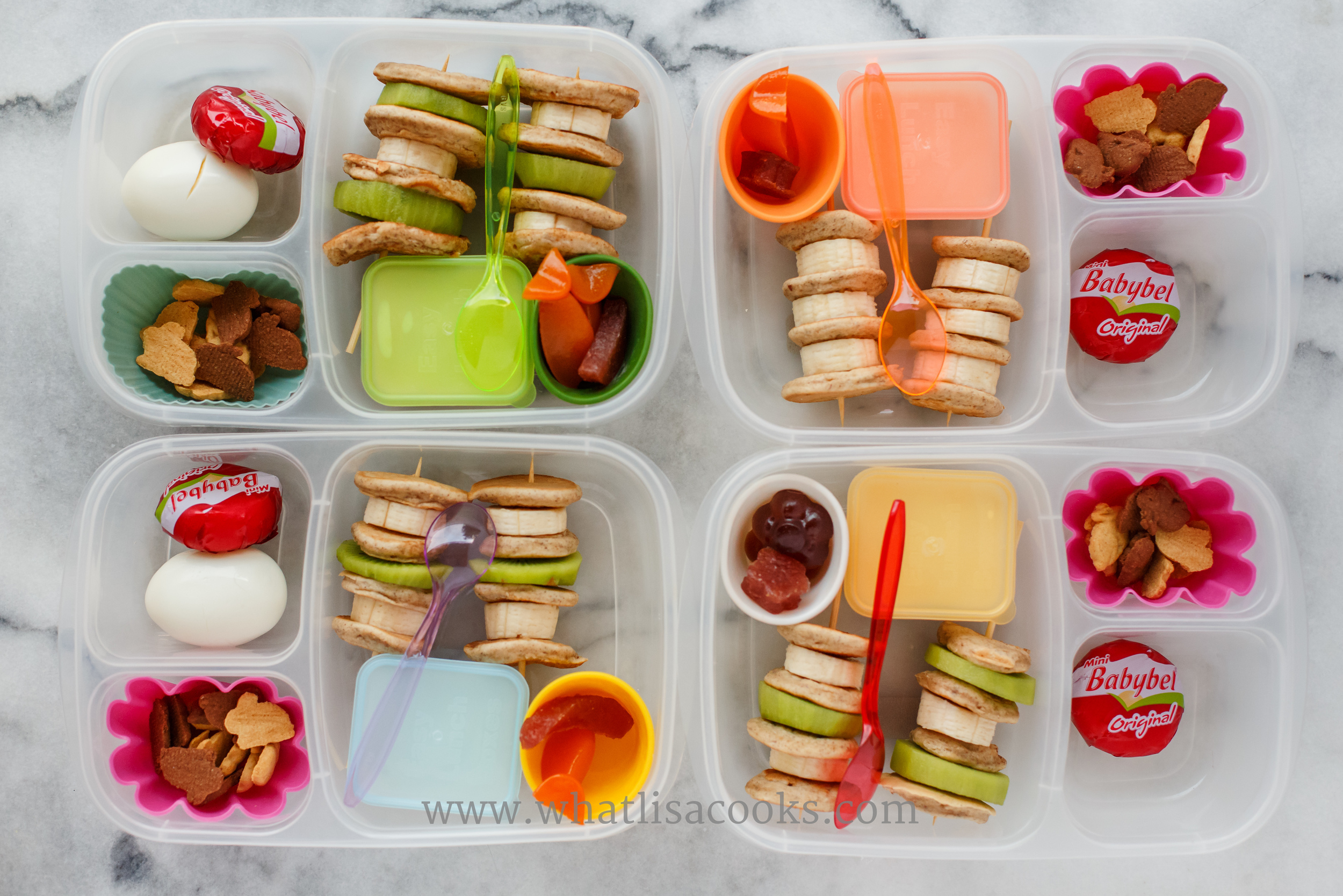 Breakfast for lunch: mini pancake kebobs with kiwi and banana, maple syrup yogurt for dipping, gummies, cheese, boiled egg, and a few bunny grahams.