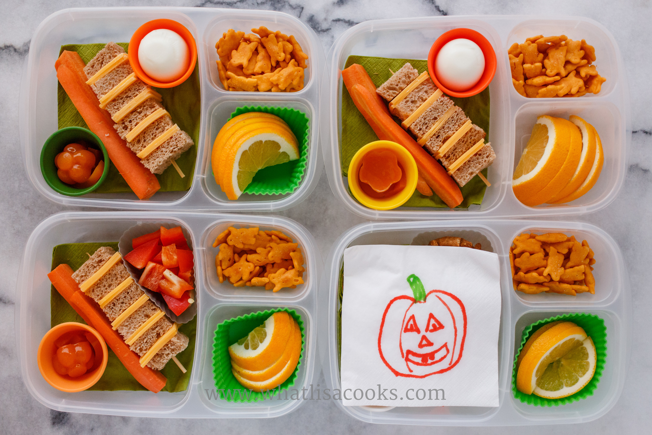 A very quick and simple Halloween lunch of all orange foods. Cheddar cheese mini sandwiches on a skewer, carrots, oranges, cheddar bunnies, and orange gel gummies.