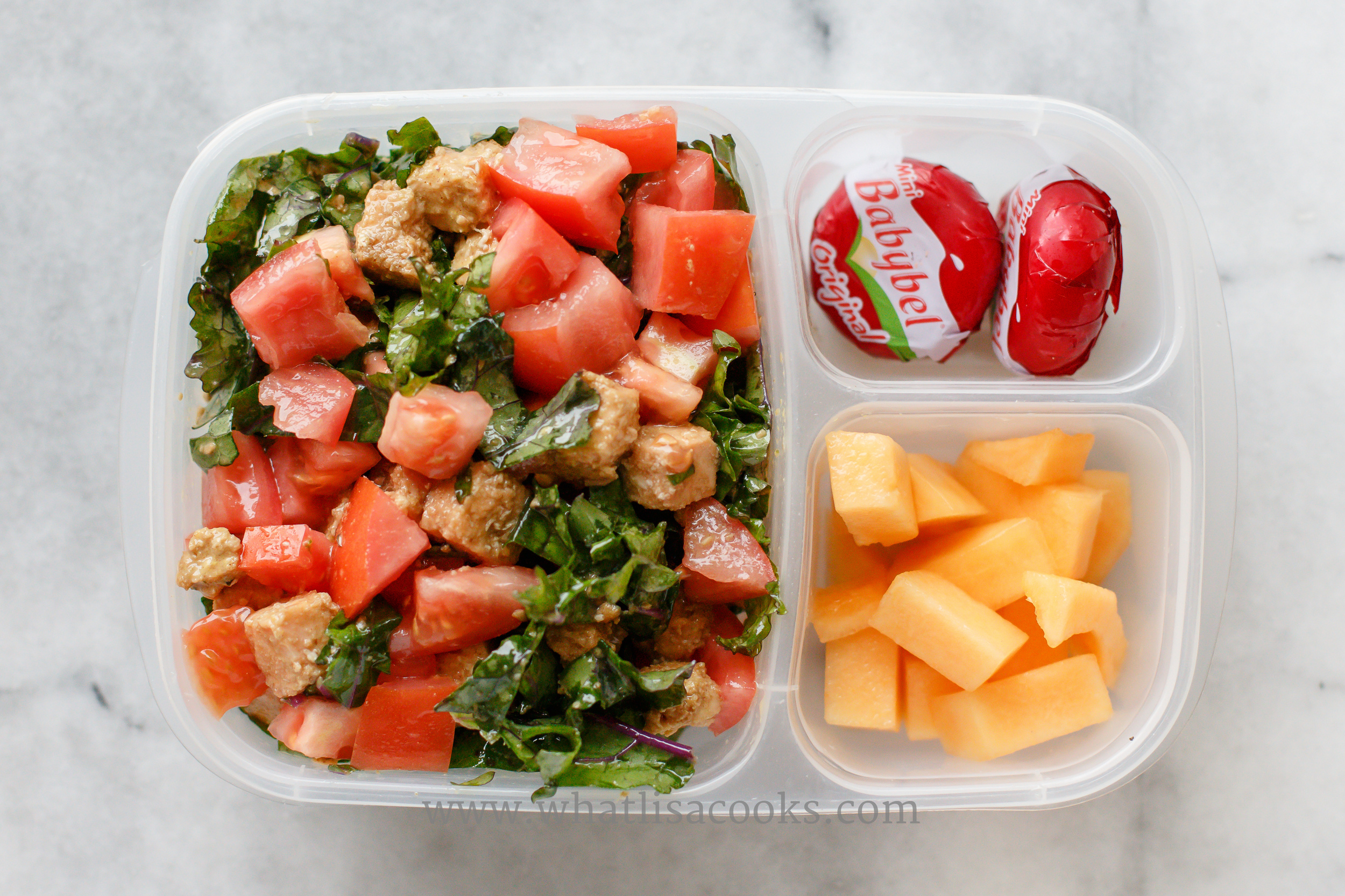A quick and easy kale salad - just quickly tossed with sesame oil and Bragg's aminos. With diced tomatoes and bites of a leftover salmon burger.  Melon and cheese on the side.