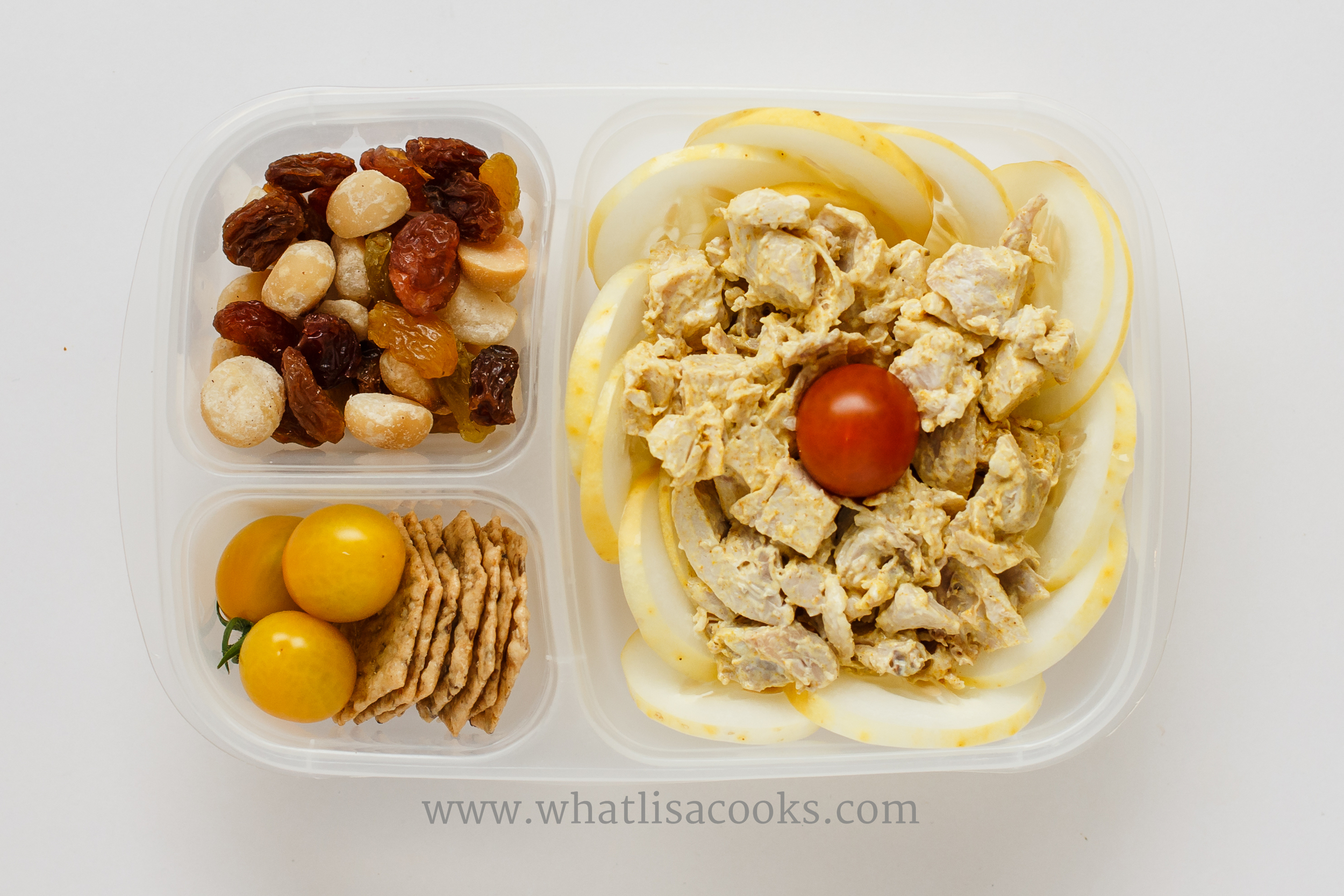 Curry chicken salad: leftover roasted chicken, mayo, curry powder and salt.  With sliced yellow cucumbers, tomatoes, rice crackers, raisins and macadamia nuts.